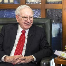 FILE - In this May 2, 2016, file photo, Berkshire Hathaway Chairman and CEO Warren Buffett is interviewed in Omaha, Neb. Buffett's Berkshire Hathaway is buying 700 million shares in Bank of America, making Buffett the largest shareholder in two of the nation's largest banks.