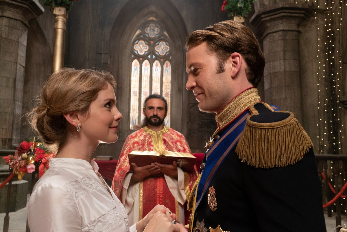 The happy couple face each other at the altar.