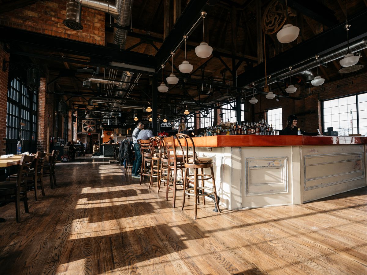The central bar inside the empty, industrial interior of Cork and Gabel.