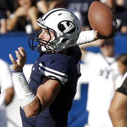 Brigham Young Cougars quarterback Jake Heaps passes the ball as Brigham Young University faces Idaho State in NCAA football in Provo, Saturday, Oct. 22, 2011.