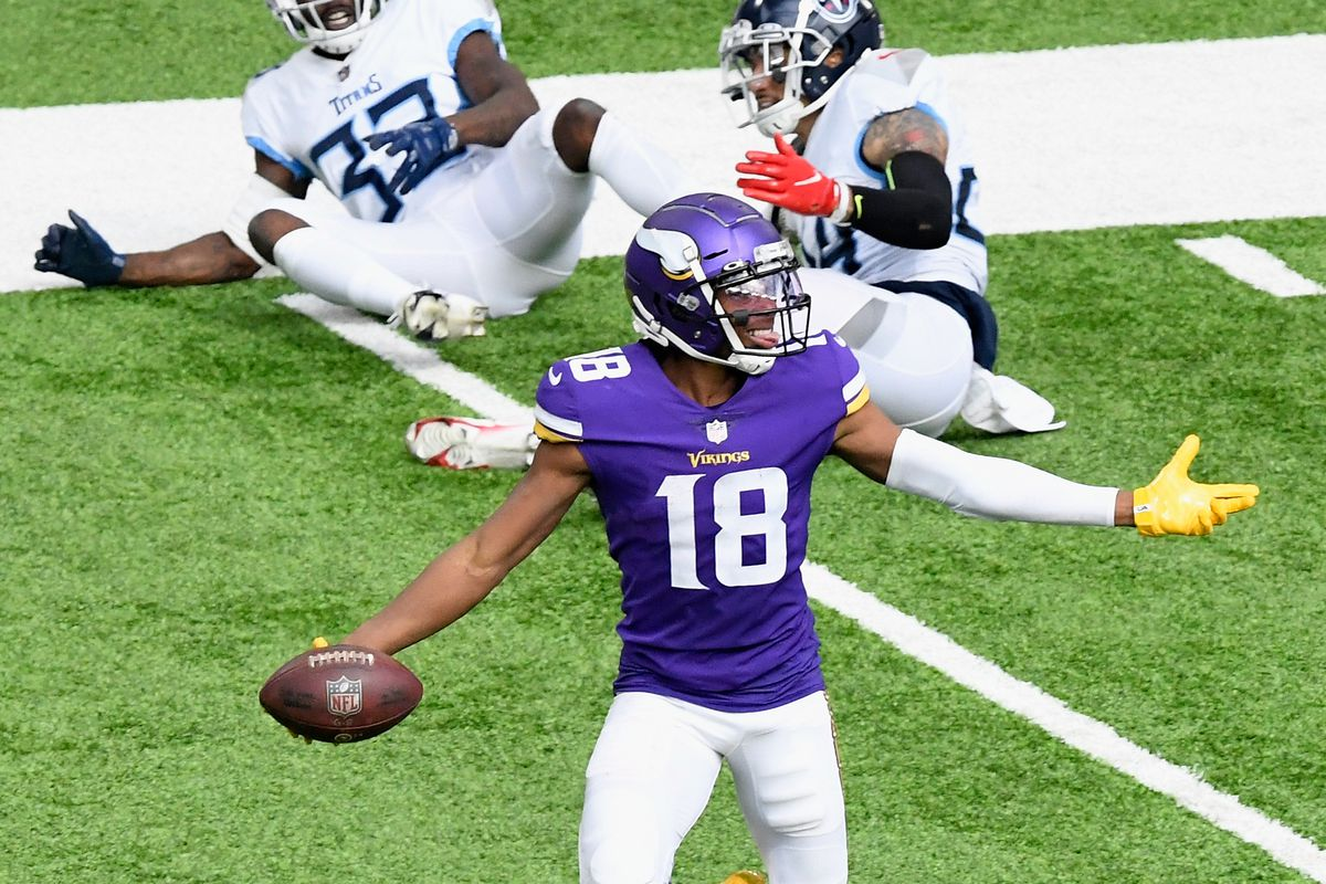 Justin Jefferson of the Minnesota Vikings avoids a tackle by Kenny Vaccaro and Johnathan Joseph 3 of the Tennessee Titans during the third quarter of the game at U.S. Bank Stadium on September 27, 2020 in Minneapolis, Minnesota.