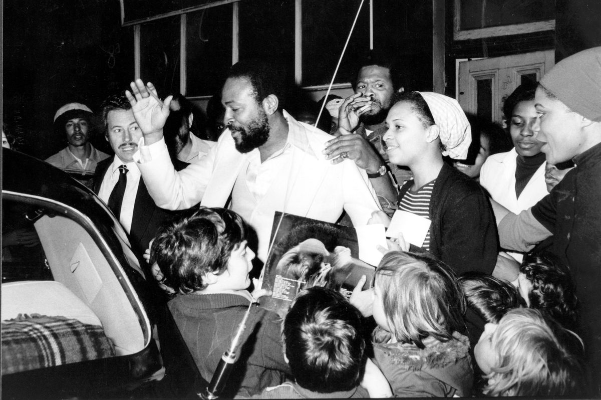 American soul singer Marvin Gaye visits the Mangrove Cafe in All Saint's Road, London, and is mobbed by admirers on the way out to his car.