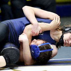 Lacie Toone of Fremont and Meridien Grandpre of Copper Hills wrestle in class 124 as girls compete for the 6A State Wrestling championship at West Lake High in Saratoga Springs on Monday, Feb. 15, 2021.