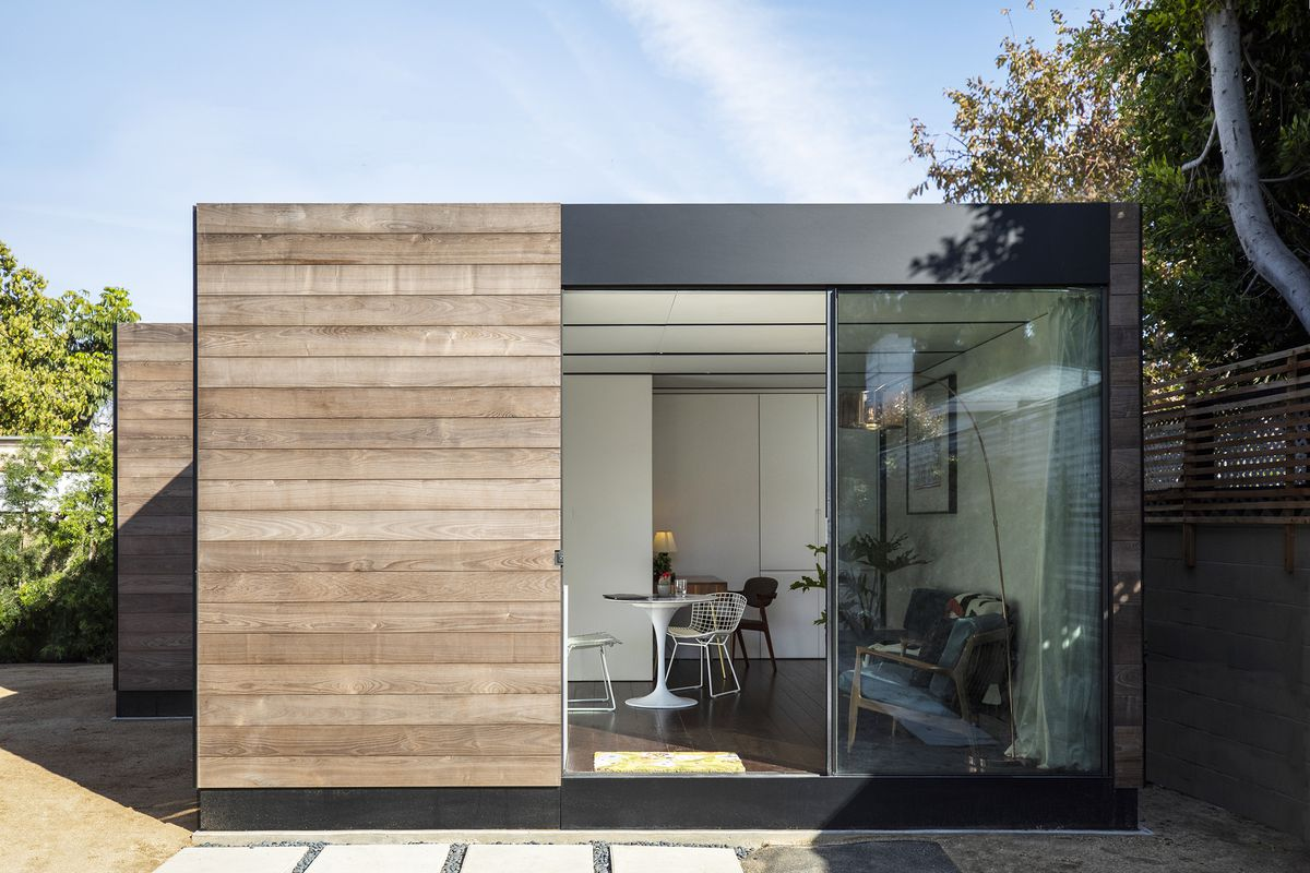 House clad in timber in backyard.