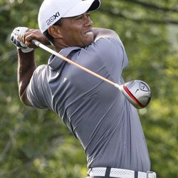 Tiger Woods tees of on the ninth holeduring the Pro-Am tournament of the BMW Championship PGA golf tournament at Crooked Stick Golf Club in Carmel, Ind., Wednesday, Sept. 5, 2012.