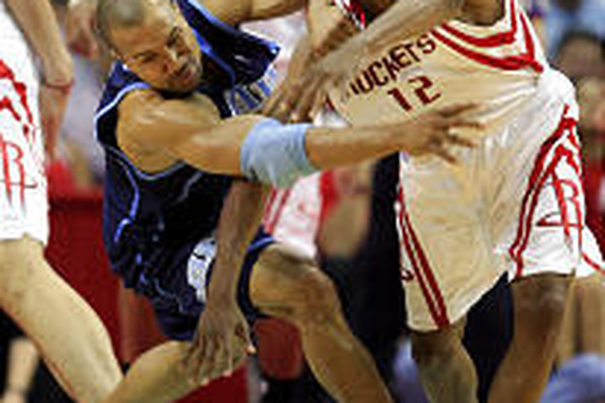Utah's Derek Fisher and Houston's Rafer Alston scramble for a loose ball during the Rockets' 98-90 Game 2 victory over the Jazz on Monday night in Houston. The best-of-seven first-round series resumes Thursday at EngerySolutions Arena in Salt Lake City.