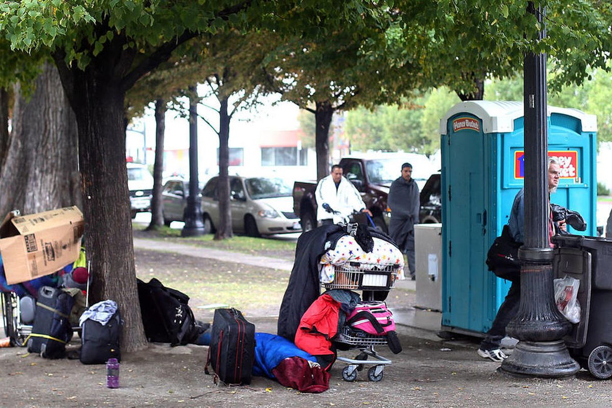 Homeless people have to keep their belongings with them in Salt Lake City's Pioneer Park on Thursday, Oct. 10, 2013. The number of homeless students has raised to record 1.1 million, according to new data from the U.S. Department of Education. States with
