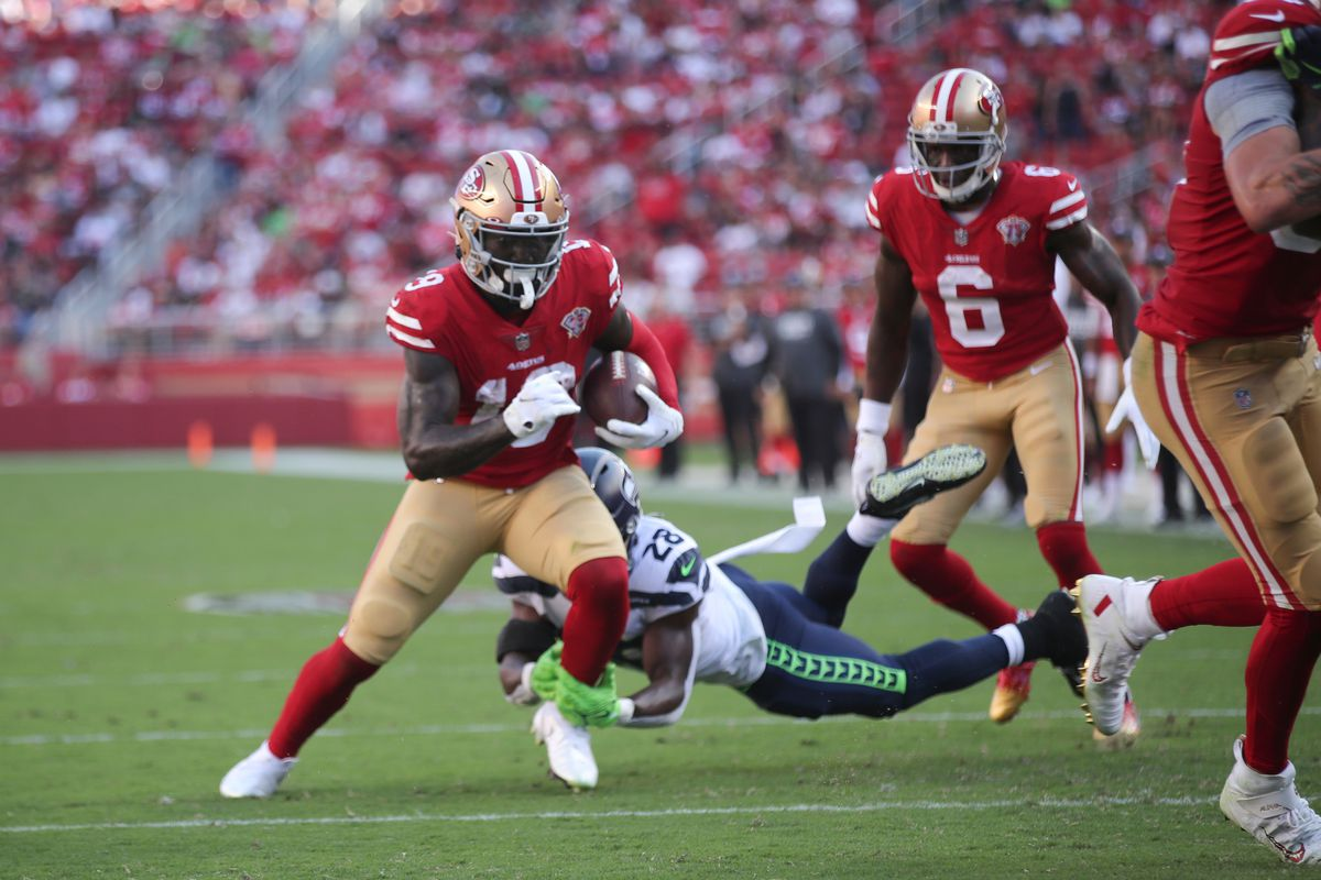 Deebo Samuel #19 of the San Francisco 49ers heads to the end zone on an 8-yard touchdown catch during the game against the Seattle Seahawks at Levi's Stadium on October 3, 2021 in Santa Clara, California. The Seahawks defeated the 49ers 28-21.