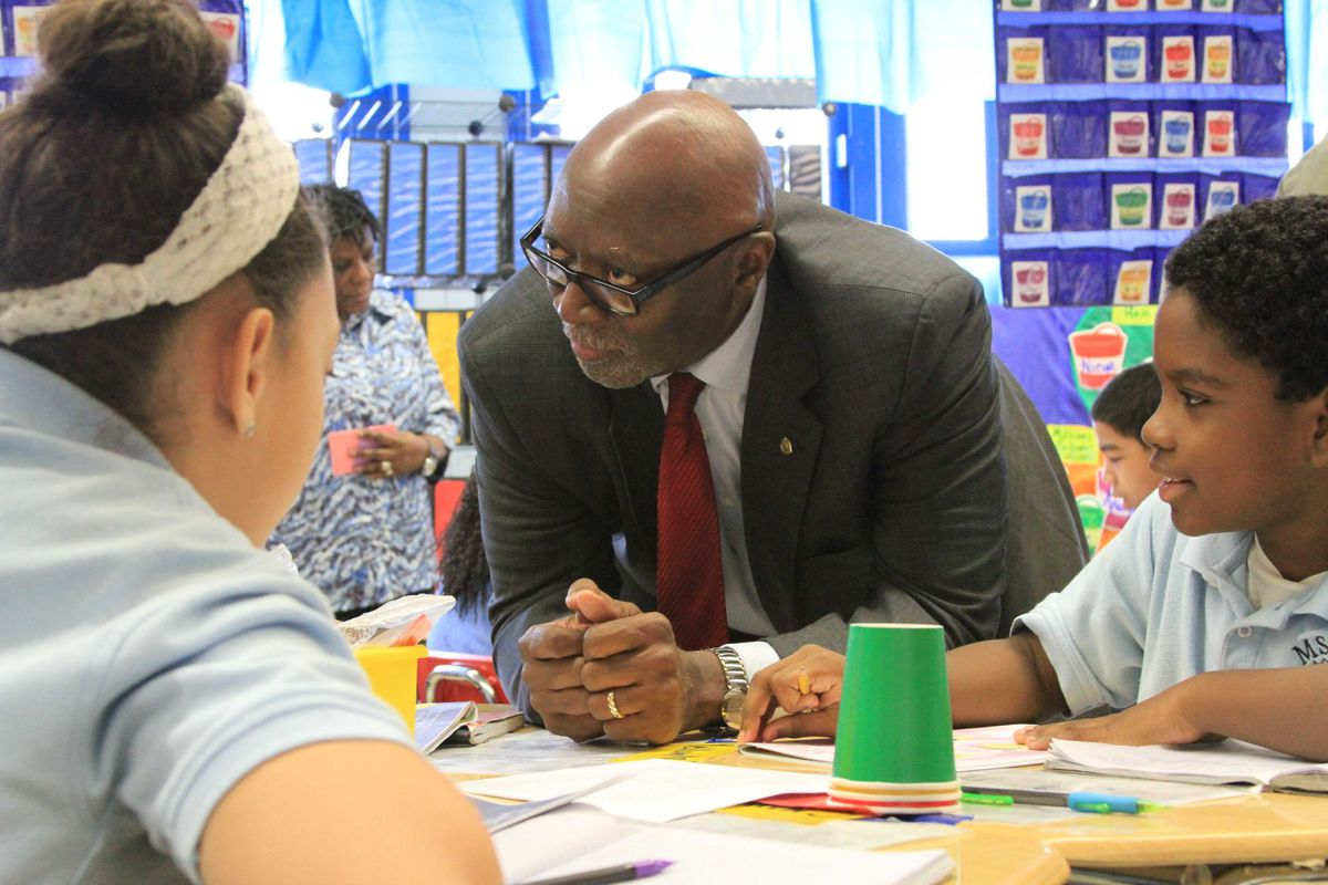Council of School Supervisors and Administrators President Ernest Logan speaks with students at The School of Integrated Learning, during a visit to the PROSE school in Brooklyn Tuesday.