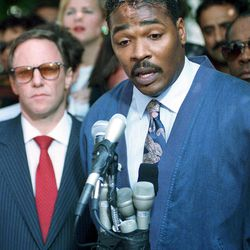 FILE-In this May 1,1992 file photo Rodney King, right, makes his first statement, pleading for an end to the rioting in South Central Los Angeles, in Los Angeles. At left is King's attorney Steven Lerman. On April 29, 1992, four white police officers were declared innocent in the beating of black motorist Rodney King, and Los Angeles erupted in the deadliest riots of the century.