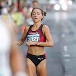 Grayson Murphy finishes first in the women's division of the Deseret News 10K at Liberty Park in Salt Lake City on Friday, July 23, 2021.