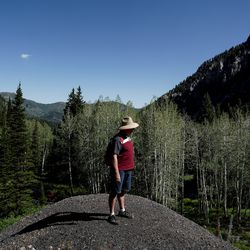 Salt Lake County Council member Richard Snelgrove stands on a pile of tailings, the waste rock left over from mining, in Mill D South Fork of Big Cottonwood Canyon on Wednesday, Aug. 12, 2020.