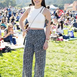 Mindy is wearing pants from a random store in Manhattan beach with a top from a shop in downtown LA, a Tory Burch bag, and Steve Madden shoes.