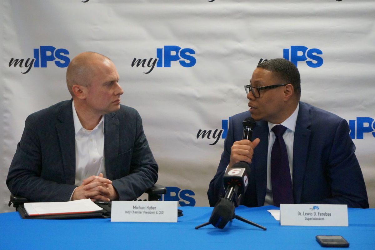 Michael Huber, left, and Lewis Ferebee at a March press conference.