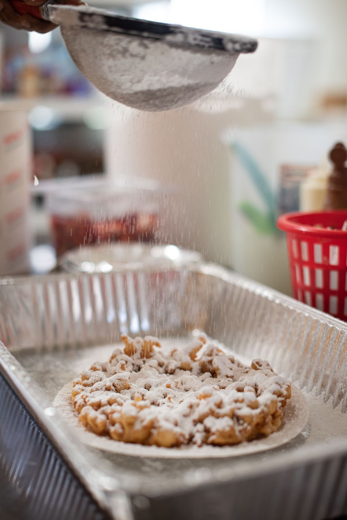 Powdered sugar sprinkled on top of a funnel cake at Fun Diggity in Compton, California.