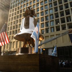 A bell, which was rung at the time the planes hit the World Trade Center in 2001, sits onstage during the commemoration of the 20th anniversary of 9/11 at the Richard J. Daley Plaza in the Loop, Saturday morning, Sept. 11, 2021.
