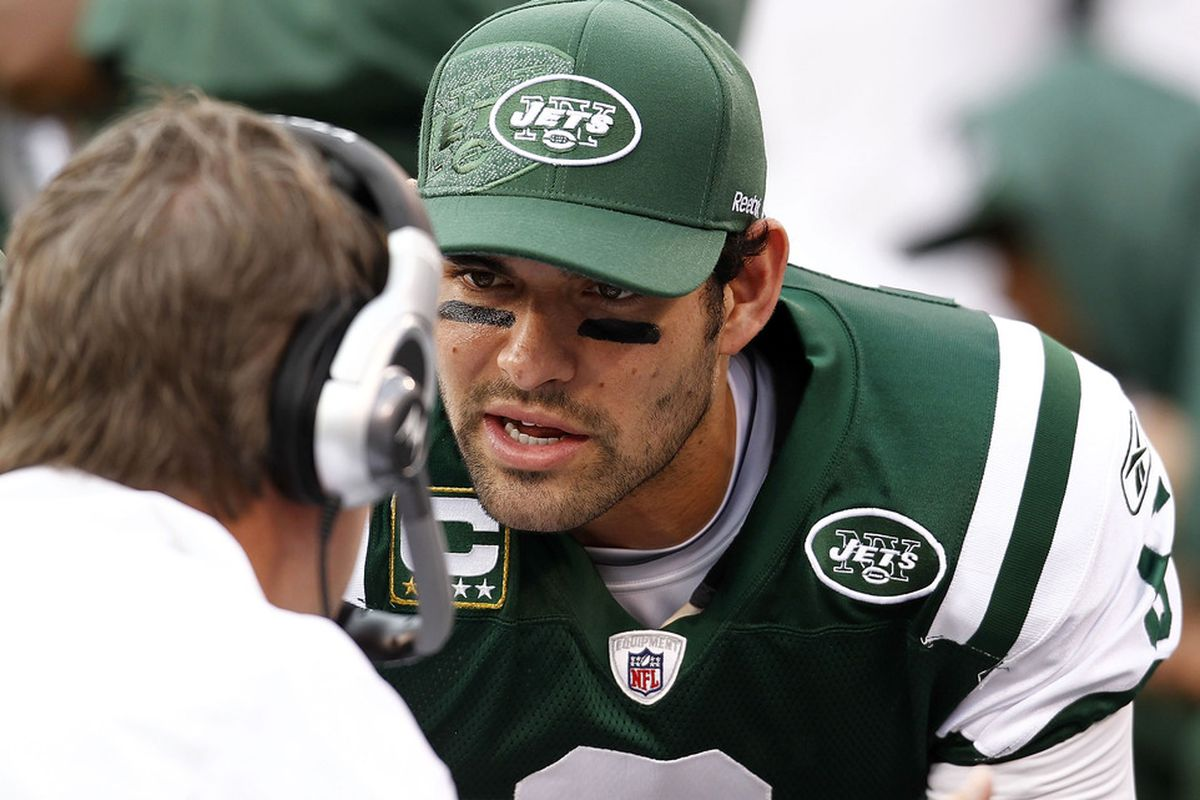 Mark Sanchez of the New York Jets talks to personnel on the bench during a game against the Buffalo Bills at MetLife Stadium on November 27, 2011 in East Rutherford, New Jersey.  (Photo by Jeff Zelevansky/Getty Images)