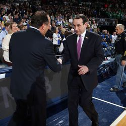 Brey and K shake hands before the game.