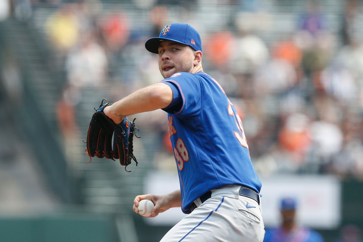 Tylor Megill #38 of the New York Mets pitches against the San Francisco Giants at Oracle Park on August 18, 2021 in San Francisco, California.