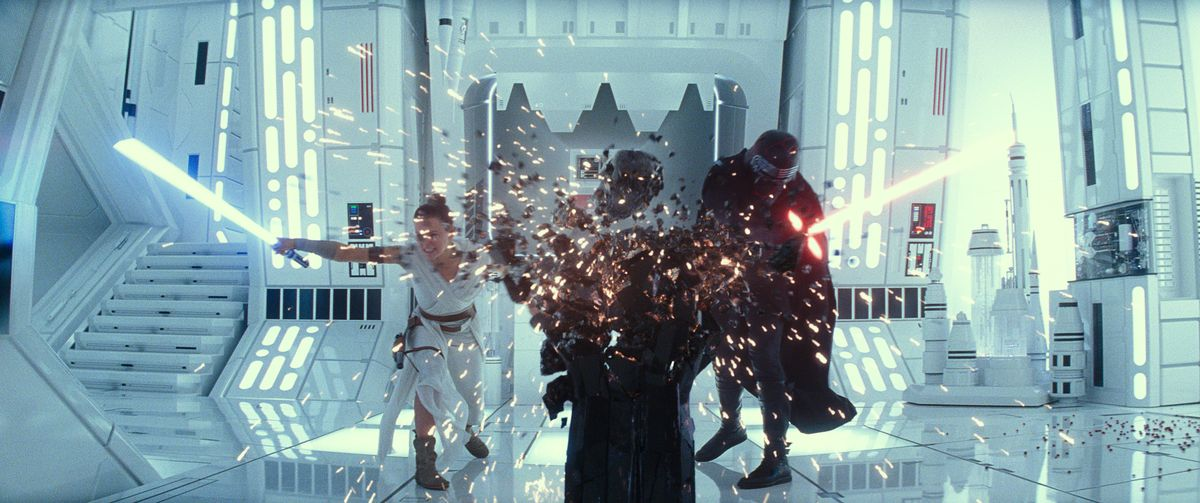 Rey and Kylo Ren fighting with lightsabers and destroying the stand for Darth Vader's destroyed mask in Star Wars: The Rise of Skywalker