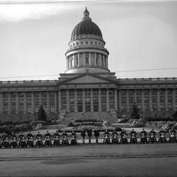 In June of 1936 the motorcycle division of the Utah Highway Patrol gather in front of the State Capitol.