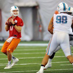 Jun 11, 2013; Davie, FL, USA; Miami Dolphins quarterback Ryan Tannehill (17) cops back to pass during practice at the Doctors Hospital Training Facility at Nova Southeastern University.