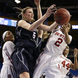 BYU's Jennifer Hamson (5) gets a rebound against North Carolina State's Len'Nique Brown (2) during the first half of a first-round game in the NCAA women's college basketball tournament on Saturday, March 22, 2014, in Los Angeles. (AP Photo/Jae C. Hong)