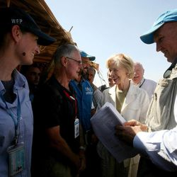 Quentin Bryce, the Australian Governor-General, second right, tours the Zaatari Syrian Refugee Camp, in Mafraq, Jordan, Sunday, Sept. 2, 2012. Bryce told the press that Australia has contributed 20 million in funds to support the refugees. Humanitarian organizations workers along with UNHCR representative to Jordan, Andrew Harper stands at right.