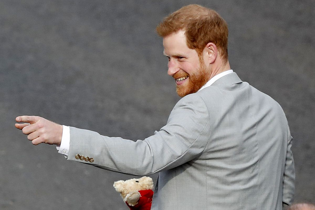 Britain's Prince Harry reacts as he greets crowds in Windsor, near London, England, Friday, May 18, 2018. The English royal is set to star in a special to celebrate the 75th anniversary of Thomas the Tank Engine.