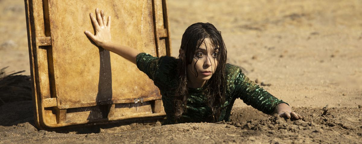 Cristin Milioti as Hazel Green emerges from a sewage pipe in the desert.