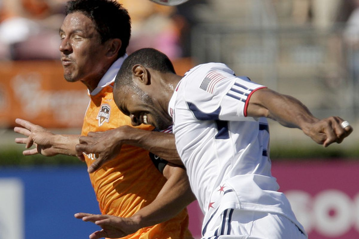 HOUSTON, TX - OCTOBER 01: Brian Ching #25 of the Houston Dynamo heads the ball away from Corben Bone #19 of the Chicago Fire on October 1, 2011 at Robertson Stadium in Houston, Texas. (Photo by Thomas B. Shea/Getty Images)