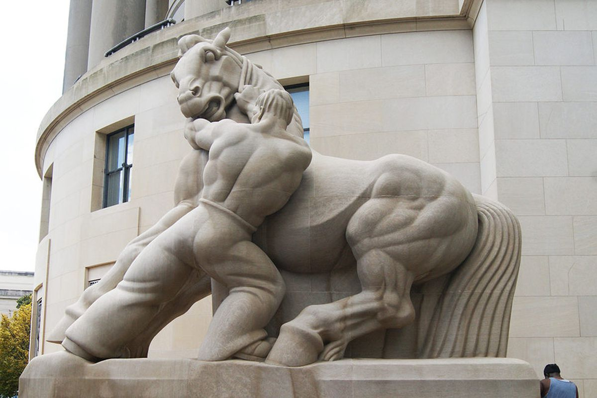 """This sculpture, one of a pair found outside of the Federal Trade Commission Building, is entitled """"Man Controlling Trade"""" and was completed for the FTC Building in 1942 by New York sculptor Michael Lantz."""