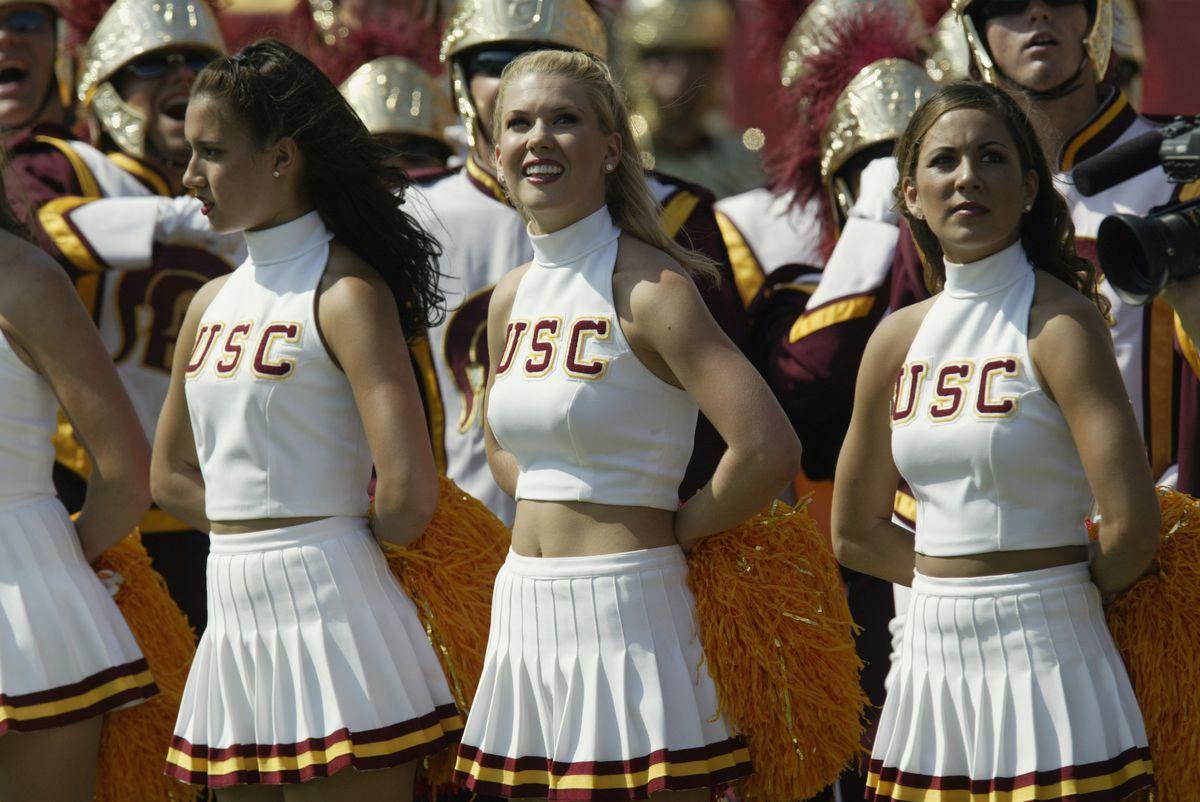 "<p zoompage-fontsize=""15"" style="""">USC cheerleaders look on"