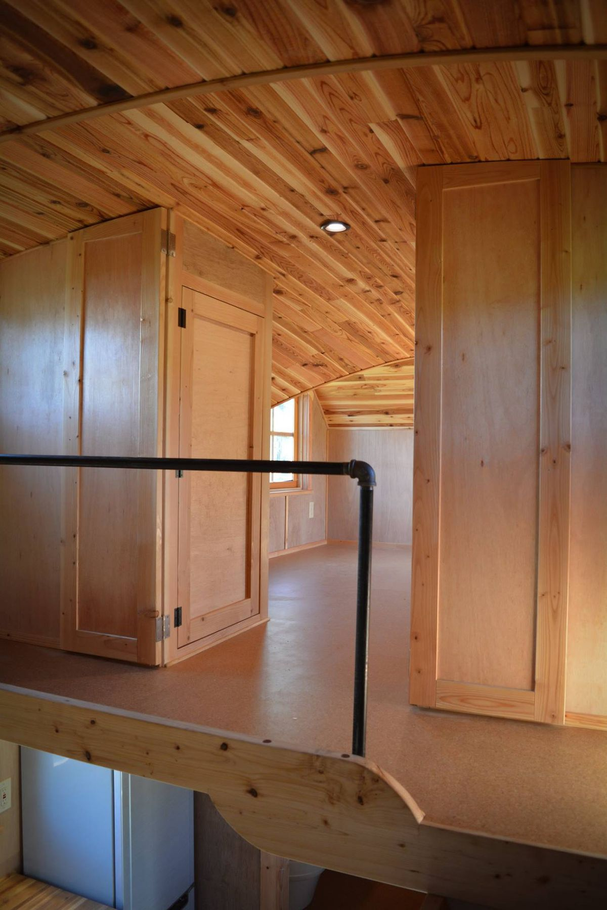 Tiny Home Designs: New Tiny House Lives Large With Extra-High Ceiling And Fun