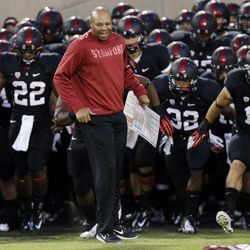Stanford head coach David Shaw leads his team onto the field at the start of an NCAA college football game against Duke in Stanford, Calif., Saturday, Sept. 8, 2012.