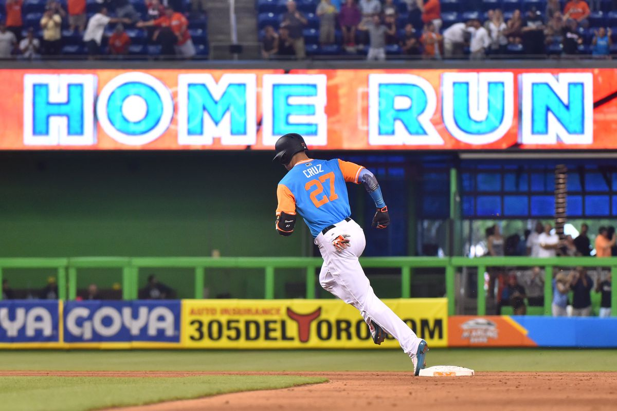MIAMI, FL - AUGUST 27: Giancarlo Stanton #27 of the Miami Marlins rounds second base after hitting his 50th home run of the season in the eighth inning against the San Diego Padres at Marlins Park on August 27, 2017 in Miami, Florida. (Photo by Eric Espada/Getty Images)