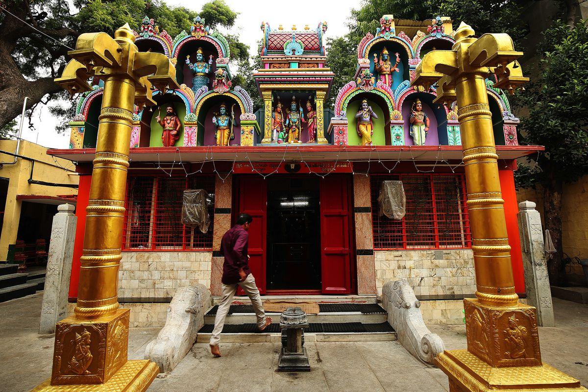A man walks into a Hindu Temple in Bangaluru, India, on Thursday, April 19, 2018.