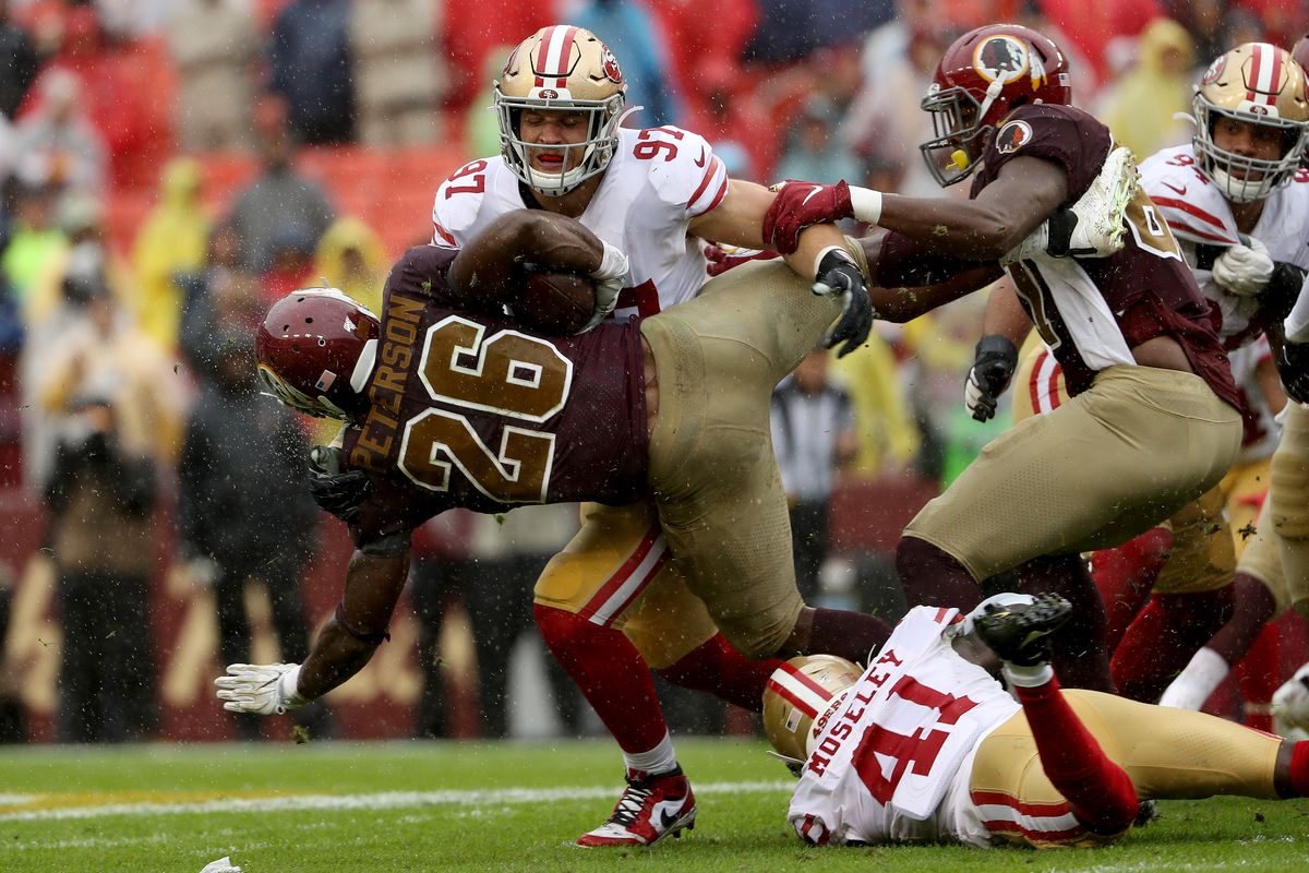 Washington running back Adrian Peterson runs the ball against Nick Bosa of the San Francisco 49ers during the first quarter in the game at FedExField on October 20, 2019 in Landover, Maryland.