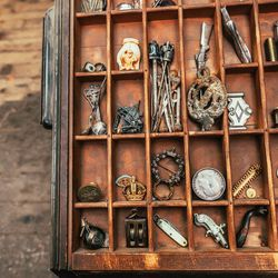 All of the prototypes and reference items get filed in an antique letter press type cabinet.