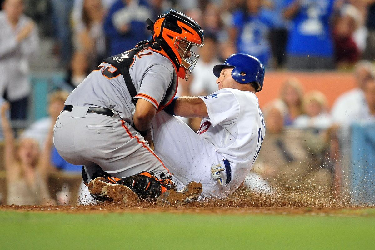 August 21, 2012; Los Angeles, CA, USA; San Francisco Giants catcher Hector Sanchez (29) stops Los Angeles Dodgers catcher A.J. Ellis (17) from scoring in the sixth inning at Dodger Stadium. Mandatory Credit: Gary A. Vasquez-US PRESSWIRE