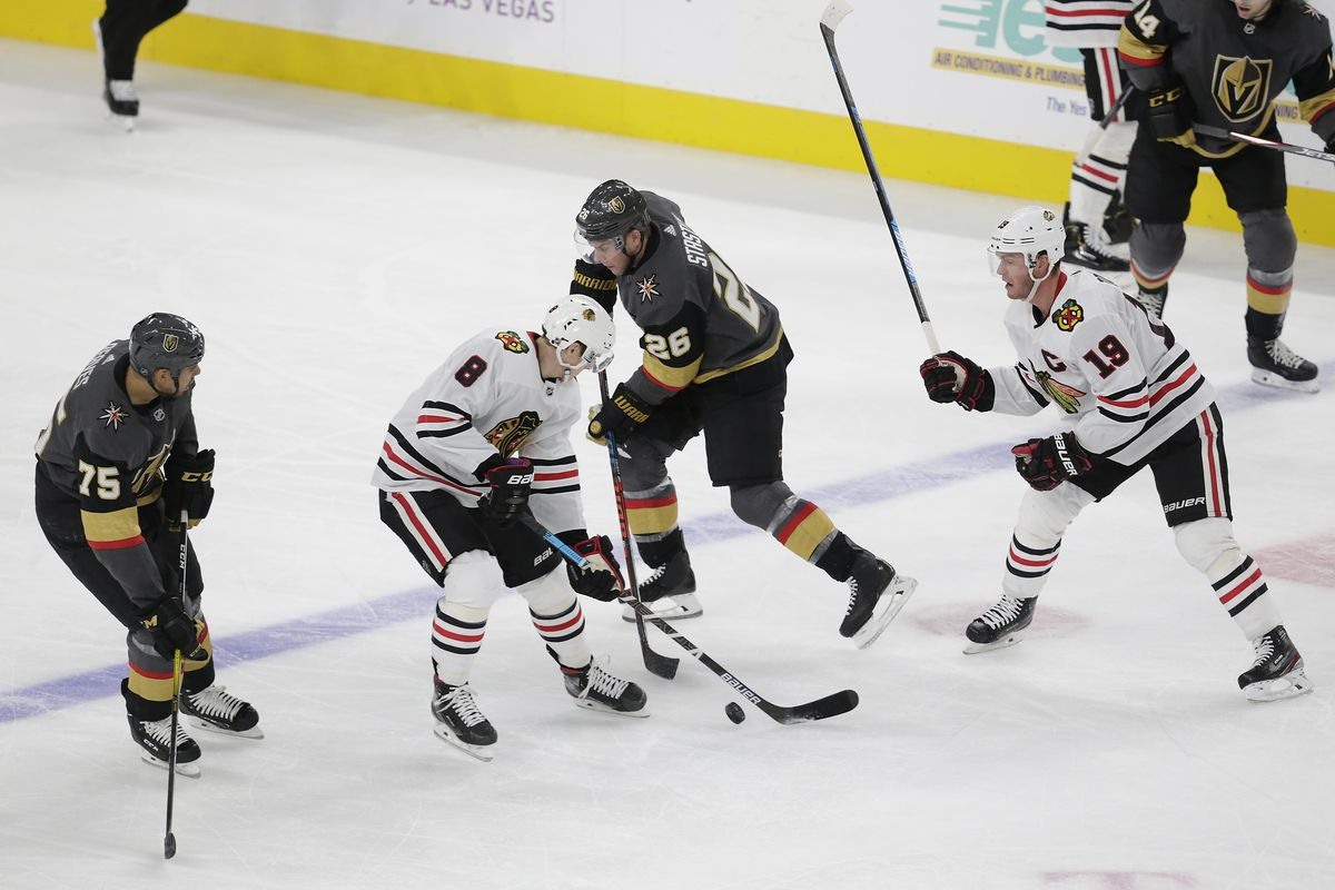 Chicago Blackhawks left wing Dominik Kubalik and Vegas Golden Knights center Paul Stastny battle for control of the puck during a regular season game Tuesday, Dec. 10, 2019, at T-Mobile Arena in Las Vegas, Nevada.