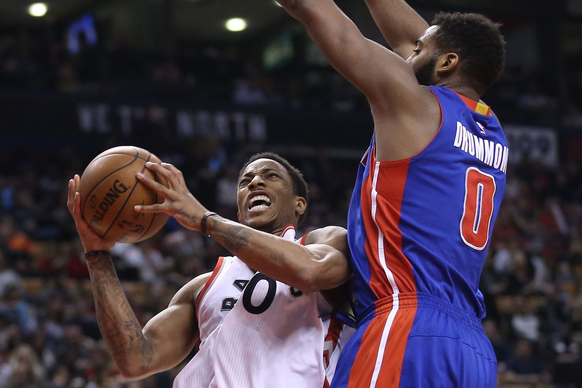 DeMar DeRozan goes to the basket against Andre Drummond (0)