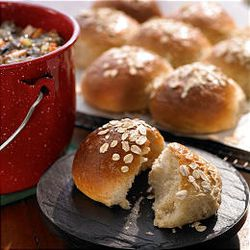 Honey Whole Wheat Rolls are topped with an egg wash and oats just before baking.