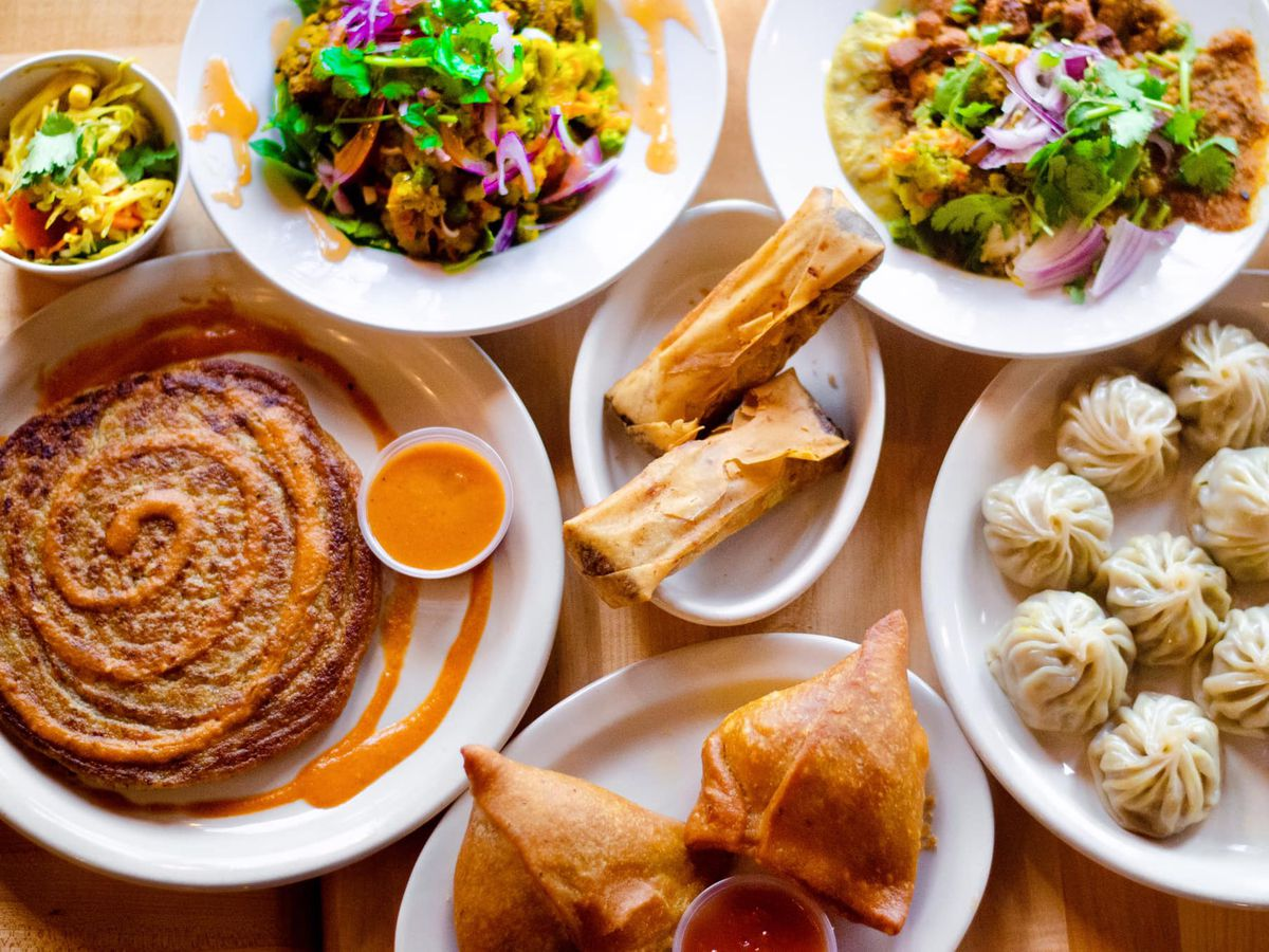 From above, a table filled with Nepali dishes