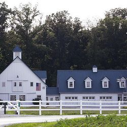 The O'Sabens built a barn originally to hold their farm equipment and furniture while their dream home was to be built. They liked it so much, they decided to call it their home. Later, a second barn was constructed and turned into a three-car garage with room for storage above.