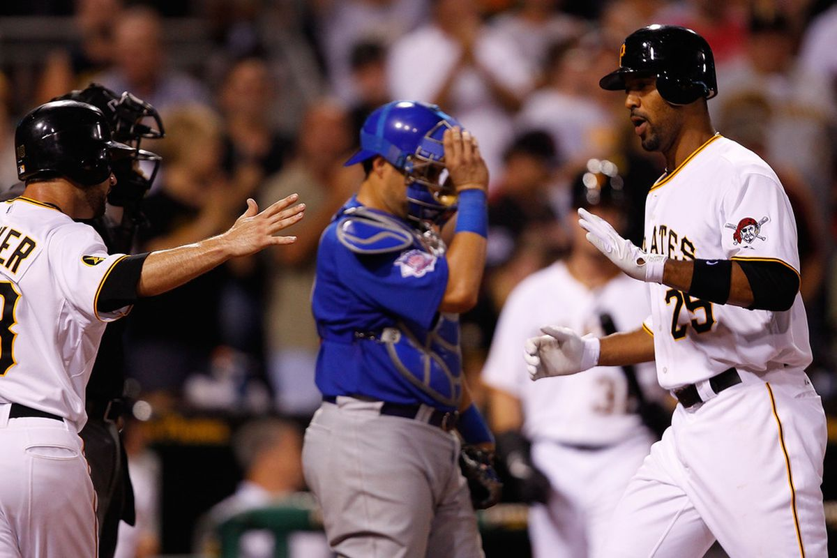 Derrek Lee of the Pittsburgh Pirates is congratulated by teammate Neil Walker after he hit a two run home run in the 8th inning against the Chicago Cubs during a game at PNC Park in Pittsburgh, Pennsylvania. (Photo by Jared Wickerham/Getty Images)