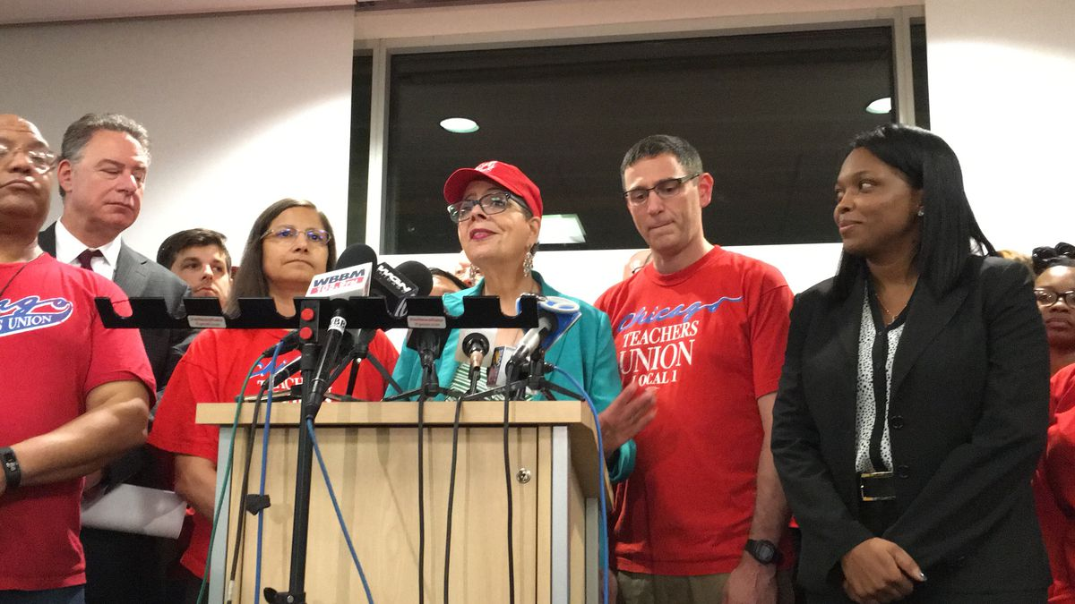 Janice Jackson (right) stands with Karen Lewis (at podium) and other Chicago Teachers Unions leaders at October 2016 news conference announcing teachers' contract. | Andy Grimm / Sun-Times files