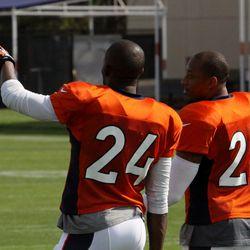 Broncos cornerbacks Champ Bailey and Chris Harris watch and discuss.