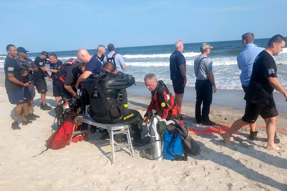 The rescue team who helped pull Matthew Wiszowaty from the waters near Shore Front Parkway and Beach 101st Street on Aug. 6.