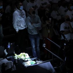 Fans stand in honor of the late Jazz Coach Jerry Sloan at halftime as the Utah Jazz and the Memphis Grizzlies play in game one of their NBA playoff series at Vivint Arena in Salt Lake City on Sunday, May 23, 2021.